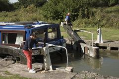 Holidaymaker opening lock on an English canal UK Stock Photography