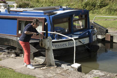 Holidaymaker opening lock on an English canal UK Royalty Free Stock Images
