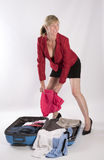 Holidaymaker packing a suitcase Stock Images