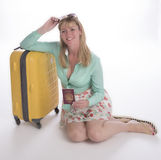 Holidaymaker with passport and suitcase Stock Image