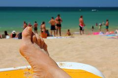 Holidaymaker relaxing on Falesia Beach in Algarve stock photos