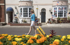Holidaymaker walking with yellow suitcase Stock Image