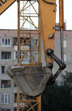 Holidaymaker yellow excavator bucket. Royalty Free Stock Images