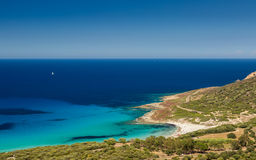 Holidaymakers and aquamarine mediterranean at Bodri beach in Cor Stock Images