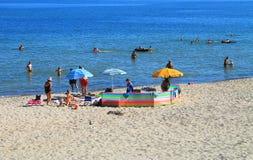 Holidaymakers on the beach of the Baltic Sea in Kulikovo, Kaliningrad region. KULIKOVO, RUSSIA — JULY 19, 2014: Holidaymakers on the beach of the Baltic Sea in Stock Photos
