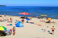 Holidaymakers on the beach of the Baltic Sea in Kulikovo, Kaliningrad region. KULIKOVO, RUSSIA — JULY 19, 2014: Holidaymakers on the beach of the Baltic Sea in Royalty Free Stock Image