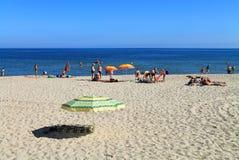 Holidaymakers on the beach of the Baltic Sea in Kulikovo, Kaliningrad region. KULIKOVO, RUSSIA — JULY 19, 2014: Holidaymakers on the beach of the Baltic Sea in Royalty Free Stock Photos