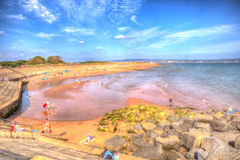Holidaymakers enjoying the heatwave in Dawlish Warren beach Devon on a summer day in 2013 Royalty Free Stock Images