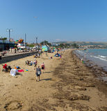 Holidaymakers enjoying the summer sunshine Swanage beach Dorset England UK Stock Photos