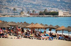 Holidaymakers on Fuengirola beach. Stock Images