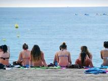 Holidaymakers In Lloret De Mar. LLORET DE MAR, SPAIN - SEPTEMBER 20, 2012: group of girls on their towels  in the beach on Septembre 20, 2012 in Lloret de Mar Stock Photo