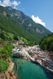 Holidaymakers on the riverside at the Alps. Stock Photo