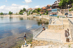 Holidaymakers on the southern embankment in the old town of Nessebar, Bulgaria Stock Photography