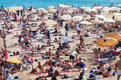 Holidaymakers sunbathe on  beach  in Barcelona Royalty Free Stock Photography