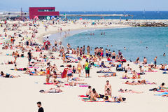 Holidaymakers sunbathing at Bogatell beach Stock Images