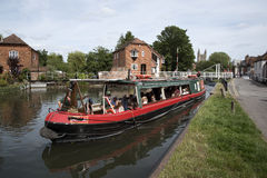 Holidaymakers taking a canal boat trip England UK Stock Photo