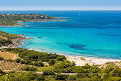 Holidaymakers and turquoise Mediterranean at Bodri beach in Cors Stock Image