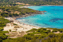 Holidaymakers and turquoise water at Bodri beach in Corsica Royalty Free Stock Image