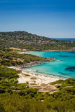 Holidaymakers and turquoise water at Bodri beach in Corsica Royalty Free Stock Images