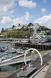Holidaymakers on a walkway in Torquay England UK Royalty Free Stock Images