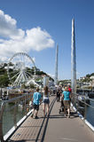 Holidaymakers on a walkway in Torquay England UK Stock Photo