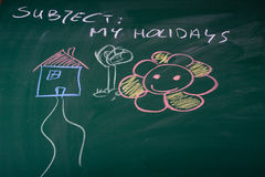 Holidays. Described on green chalkboard Stock Photos