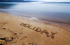 Holidays. Writing on this fabulous sandy beach Royalty Free Stock Photo