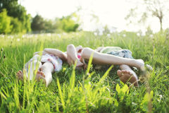 Holidays. Children lying on the grass Royalty Free Stock Images