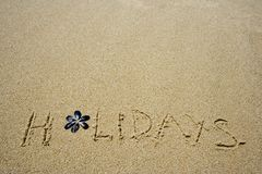 Holidays. Written in the sandy beach Royalty Free Stock Images