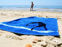 Holidays. Glasses and towel at the beach royalty free stock photos