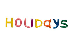 Holidays. Plasticine letters isolated on a white background Stock Photo