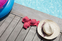 For holidays around the pool, a hat and bikini Royalty Free Stock Images