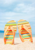 Holidays Background. Beach sandals on the sandy coast Royalty Free Stock Images