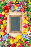 Holidays background chalkboard. Spring flowers easter eggs Royalty Free Stock Photos