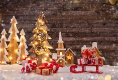 Holidays background with illuminated Christmas tree, sledge with royalty free stock images