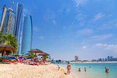 Holidays on the beach in Abu Dhabi. ABU DHABI, UAE - MARCH 28: People resting on the beach of Khalidiya Palace by Rotana on March 28, 2014, UAE. Rotana Hotel Stock Photography