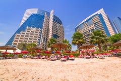 Holidays on the beach in Abu Dhabi. ABU DHABI, UAE - MARCH 28: People resting on the beach of Khalidiya Palace by Rotana on March 28, 2014, UAE. Rotana Hotel Royalty Free Stock Image