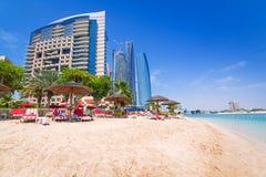Holidays on the beach in Abu Dhabi. ABU DHABI, UAE - MARCH 28: People resting on the beach of Khalidiya Palace by Rotana on March 28, 2014, UAE. Rotana Hotel Stock Images