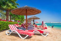 Holidays on the beach in Abu Dhabi. ABU DHABI, UAE - MARCH 28: People resting on the beach of Khalidiya Palace by Rotana on March 28, 2014, UAE. Rotana Hotel Stock Photo