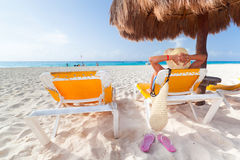 Holidays on the beach in Mexico. Woman at relaxation under parasol at Caribbean Sea Stock Images