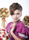 Holidays - beauty girl with festive flowers Royalty Free Stock Photos