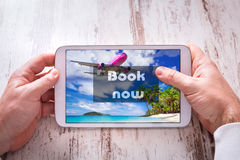 Holidays booking on tablet pc Royalty Free Stock Photography