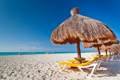 Holidays at Caribbean Sea. Holidays under parasol on Caribbean beach in Mexico Royalty Free Stock Photography