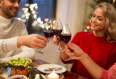 Close up of friends with wine celebrate christmas stock photo