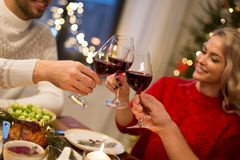 Close up of friends with wine celebrate christmas royalty free stock image