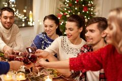 Friends celebrating christmas and drinking wine royalty free stock photos