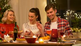 Happy friends having christmas dinner at home stock footage