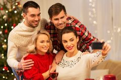 Friends taking selfie at christmas dinner royalty free stock photos