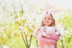 Holidays celebration concept. Hapyy easter holidays eggs and bunny Holidays celebration concept. Child smiling with bunny ears headband on long hair. Childhood royalty free stock photos