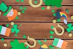 St patricks day decorations on wooden background. Holidays and celebration concept - st patricks day decorations made of paper on wooden background Royalty Free Stock Image